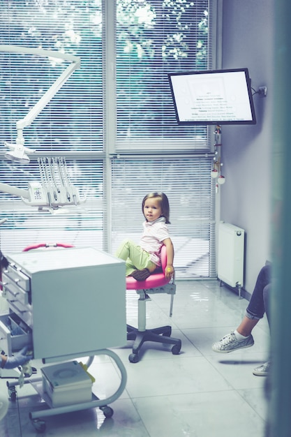 Pediatric dentist. little girl at the reception at the dentist. Free Photo