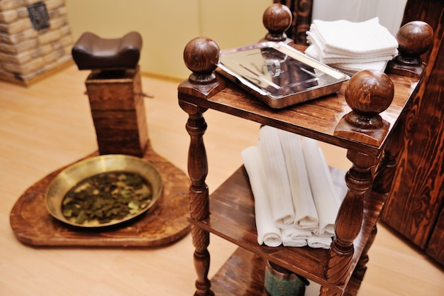 A pedicure tray with oak leaves on a spa salon Premium Photo