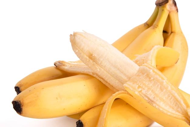 Peeled banana on white background Premium Photo