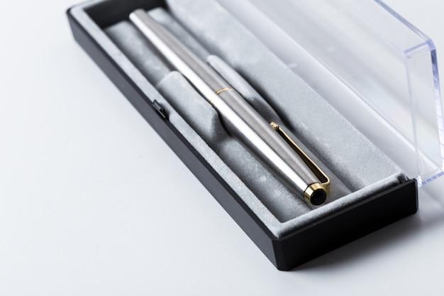 Pen in box on white background Premium Photo