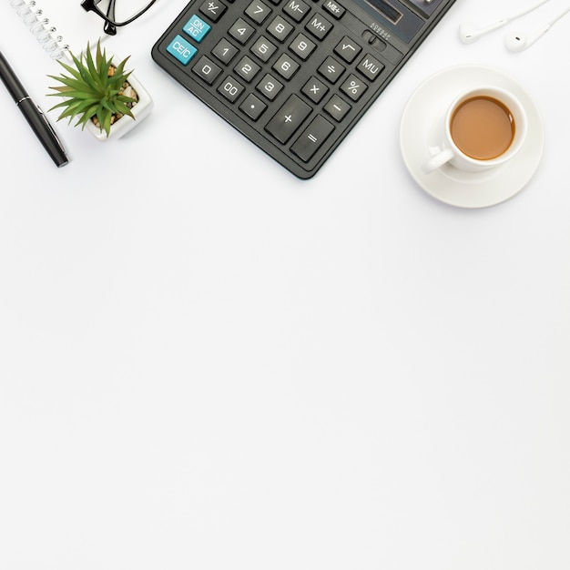 Premium Photo Pen Cactus Plant Calculator Earphones And Coffee Cup On White Background