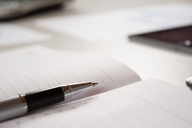 Pen on an empty agenda page Premium Photo