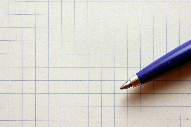 Pen and graph paper Free Photo