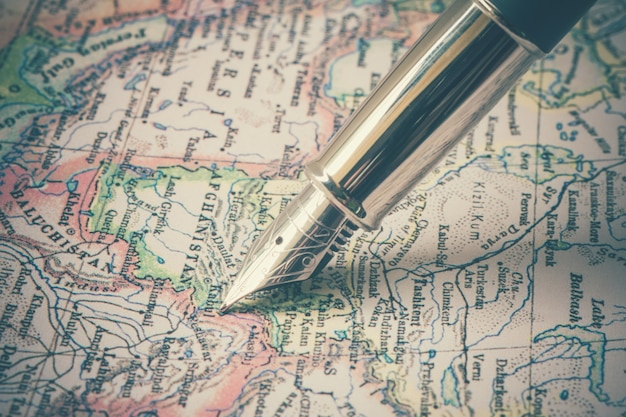 Pen and a map  with filter effect retro vintage style Premium Photo