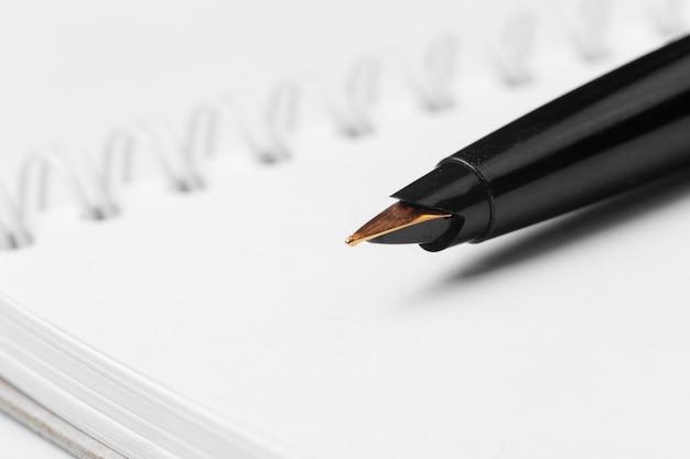 Pen and notebook Premium Photo