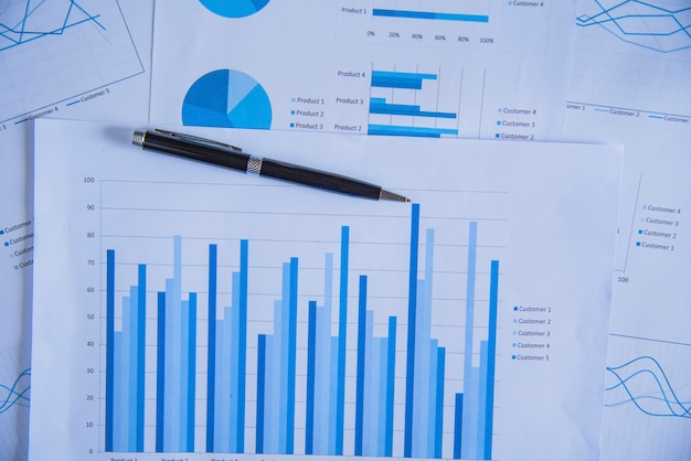 Pen On Diagram Chart And Graphs Business Report With Money Compass