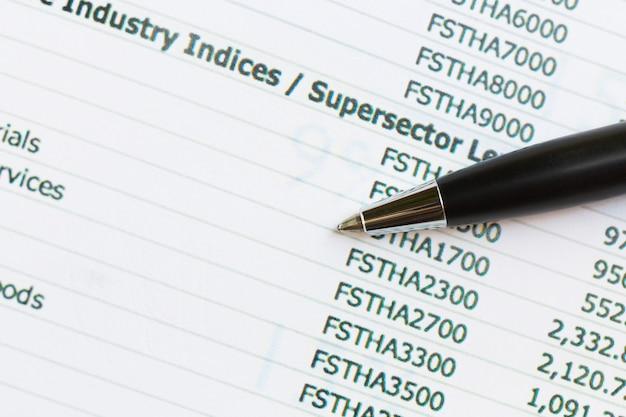 Pen with financial graphs,business concept. Premium Photo