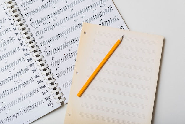 Pencil and mpty pages on sheet music Free Photo