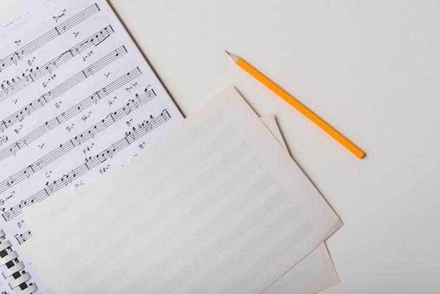 Pencil near sheet music Premium Photo