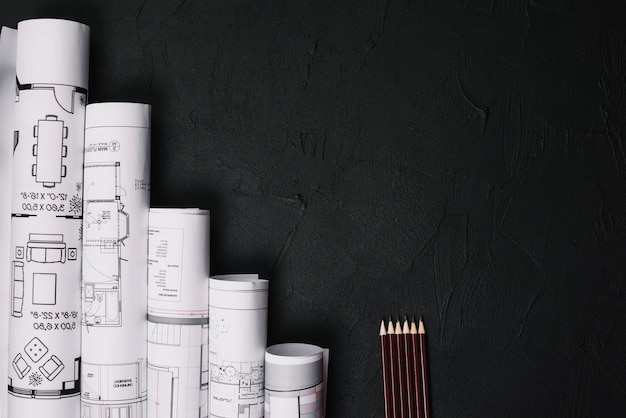 Pencils and blueprints on table Free Photo
