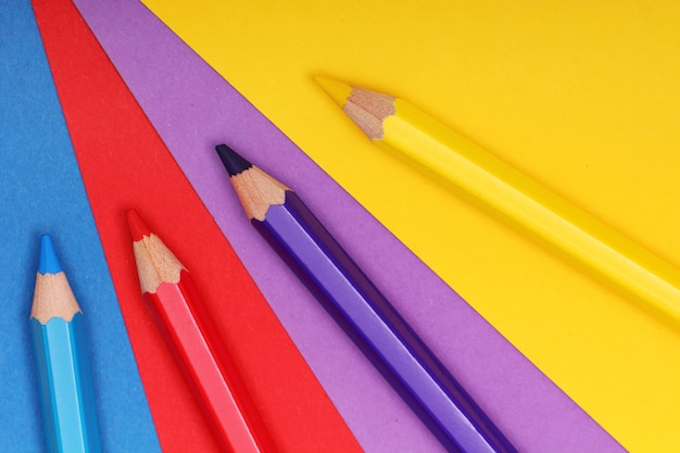 Pencils on colorful paper Free Photo