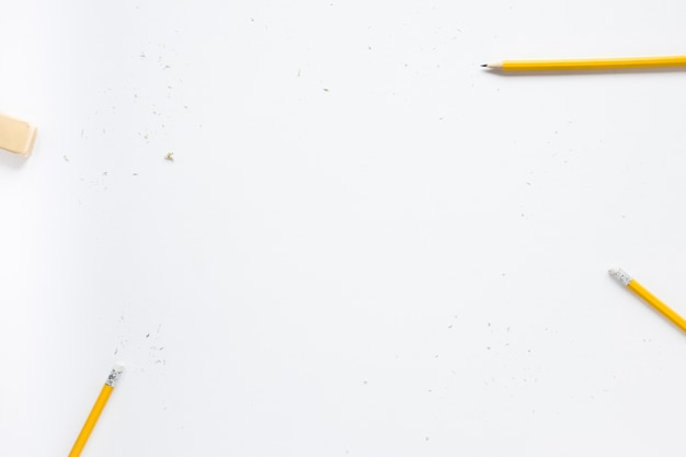 Pencils and eraser on white background Free Photo