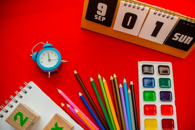 Pencils notepad numbers a b c alphabet waterolors. Premium Photo