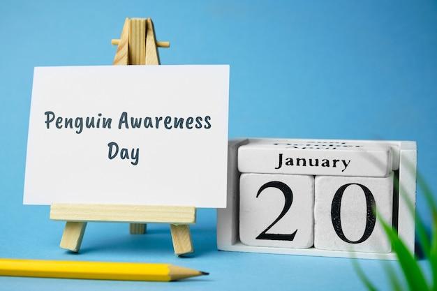 Penguin awareness day of winter month calendar january. Premium Photo