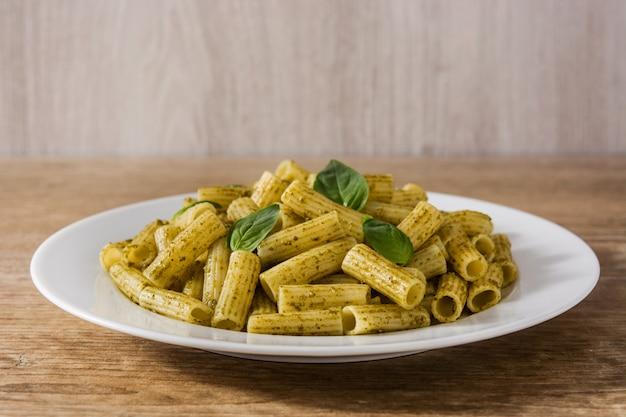Penne pasta with pesto sauce Premium Photo