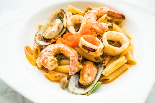 Penne seafood tom yum pasta Free Photo