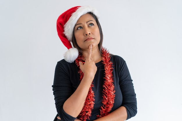 Pensive assistant planning office christmas party Free Photo