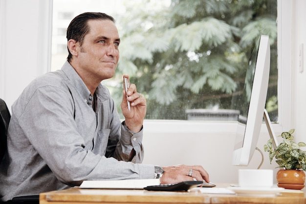 Pensive businessman at office desk Free Photo