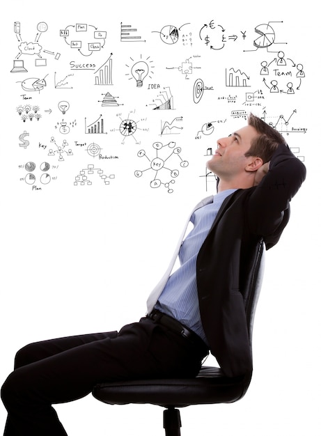Pensive businessman with diagrams background Free Photo
