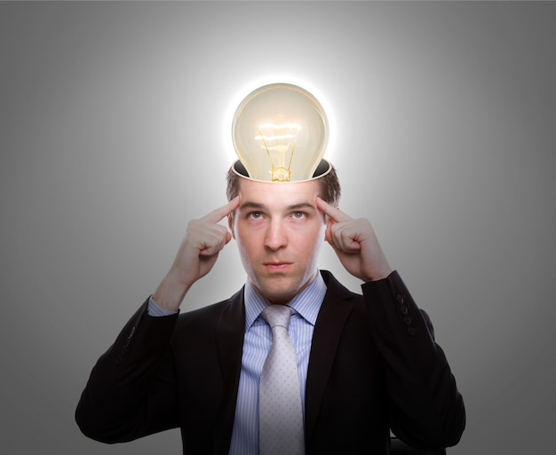 Pensive man with a light bulb on his head Free Photo