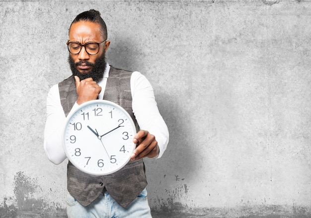 pensive man with tie looking at a clock photo free download