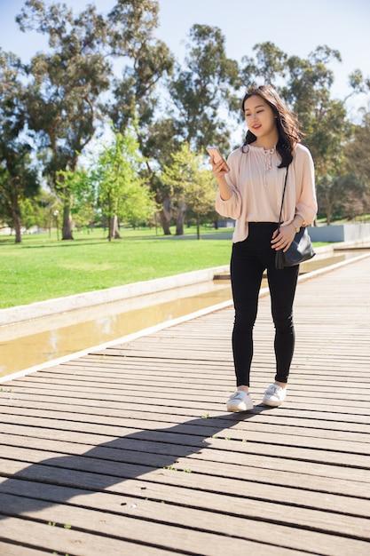 Pensive student girl using smartphone Free Photo