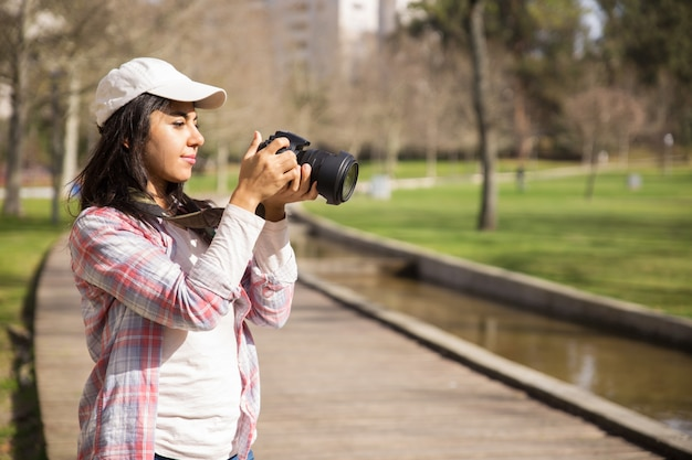 Pensive traveler walking around park Free Photo