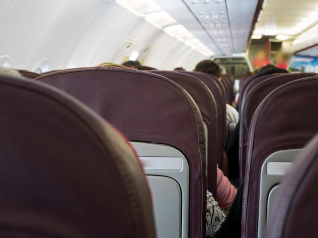 People in air plane ready to leave Free Photo