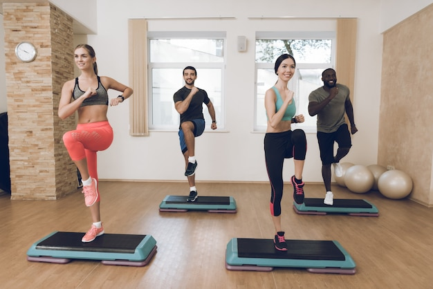 People are engaged in fitness in the modern gym with friends Premium Photo