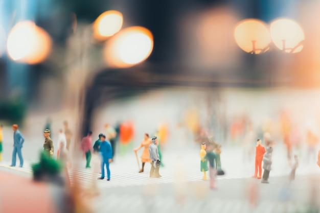 People are moving across the pedestrian crosswalk in the city Premium Photo