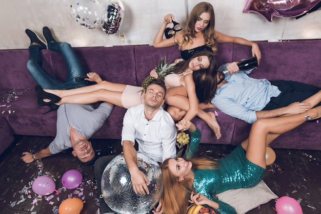 People are resting after a tumultuous party in a nightclub Premium Photo