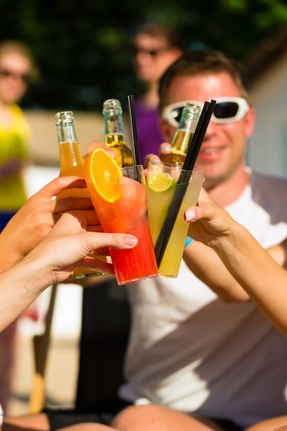 People at beach drinking having a party Premium Photo