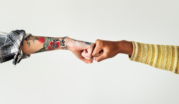 People bumping their fists together Premium Photo