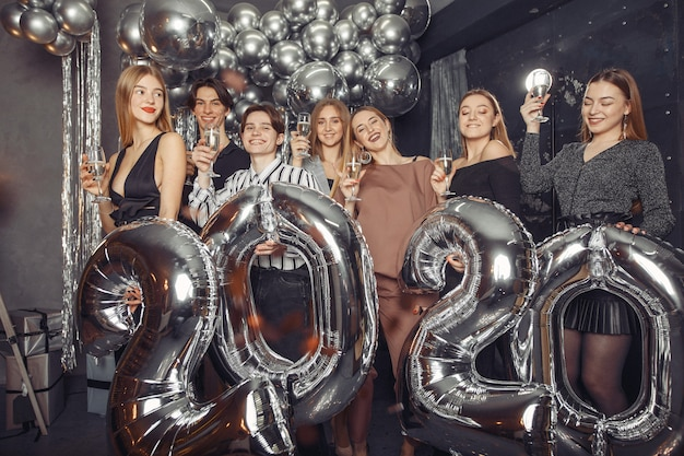 People celebrating a new year with a big ballons Free Photo