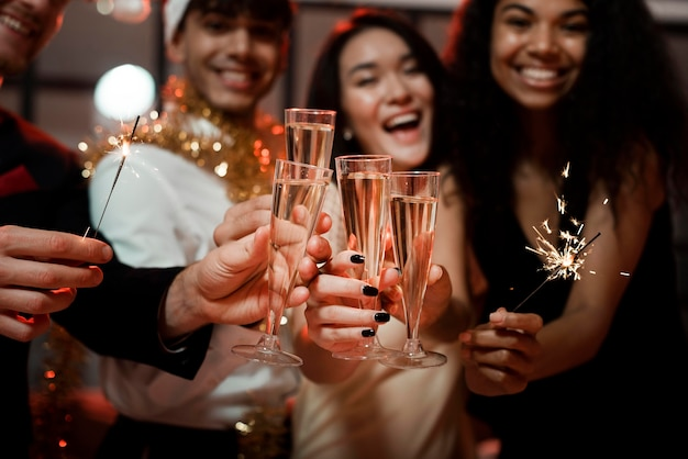 People cheering at a new year's eve party Premium Photo