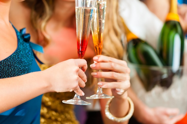 People in club or bar drinking champagne Premium Photo