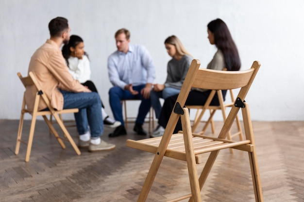 People conversing at a group therapy session Free Photo