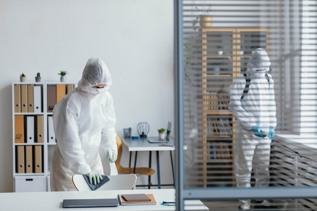 People disinfecting a biohazard area Free Photo