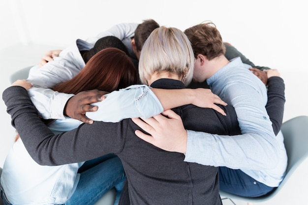 People embracing and gathering in a circle | Free Photo