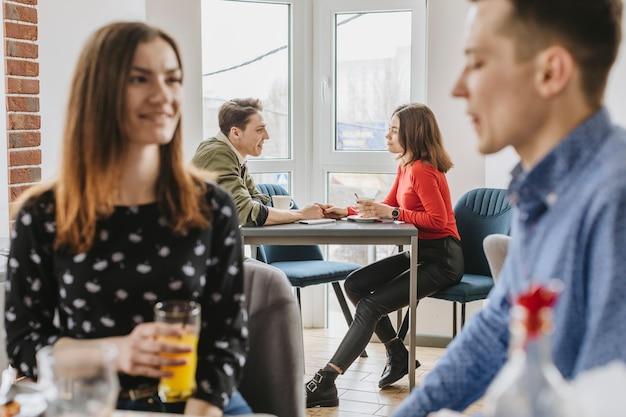 People enjoying in a restaurant Free Photo