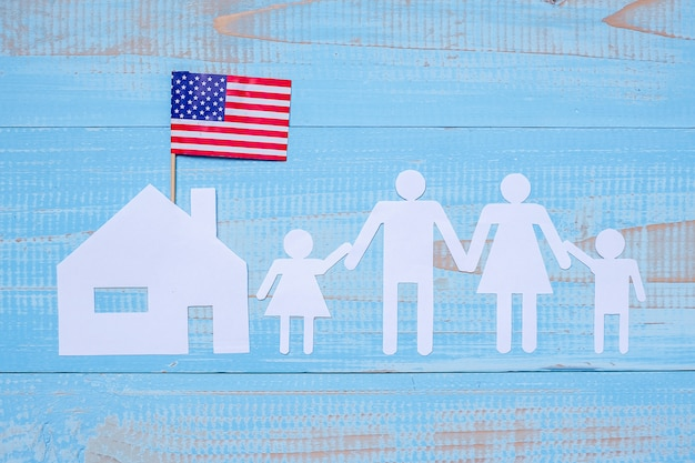 People or family and home paper shape with  flag of the united states of america Premium Photo