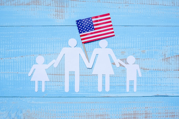 People or family paper shape with  flag of the united states of america Premium Photo