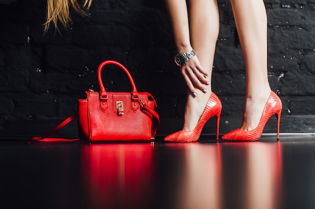People, fashion and footwear , close up of woman legs in red high heeled shoes Premium Photo