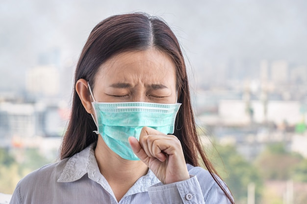 Premium Photo | People feeling sick from air pollution, environment has  harmful or poisonous effects. woman in the city wearing face mask to  protect herself because level of pollution in the air