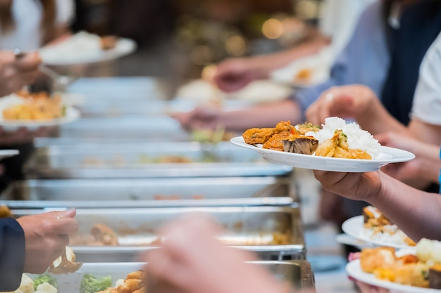 People group catering buffet food indoor in luxury restaurant with meat colorful fruits and vegetabl Premium Photo