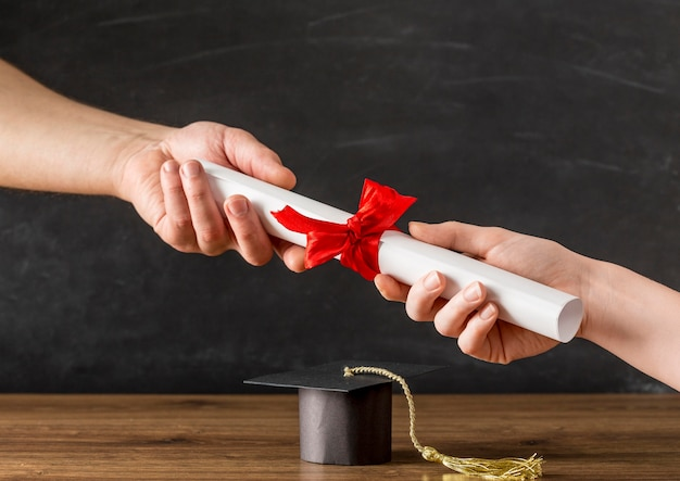 People handing a diploma to each other Free Photo