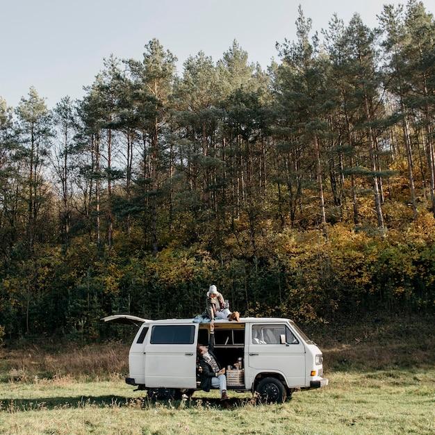 People having a road trip in a van Free Photo