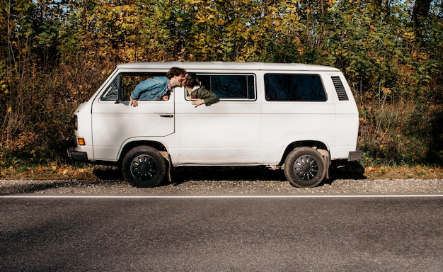People having a roadtrip in a white van Free Photo