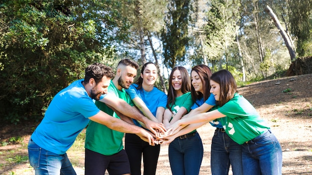 People having team building in forest Free Photo