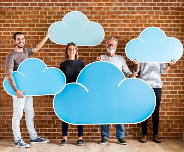 People holding cloud computing icons Premium Photo
